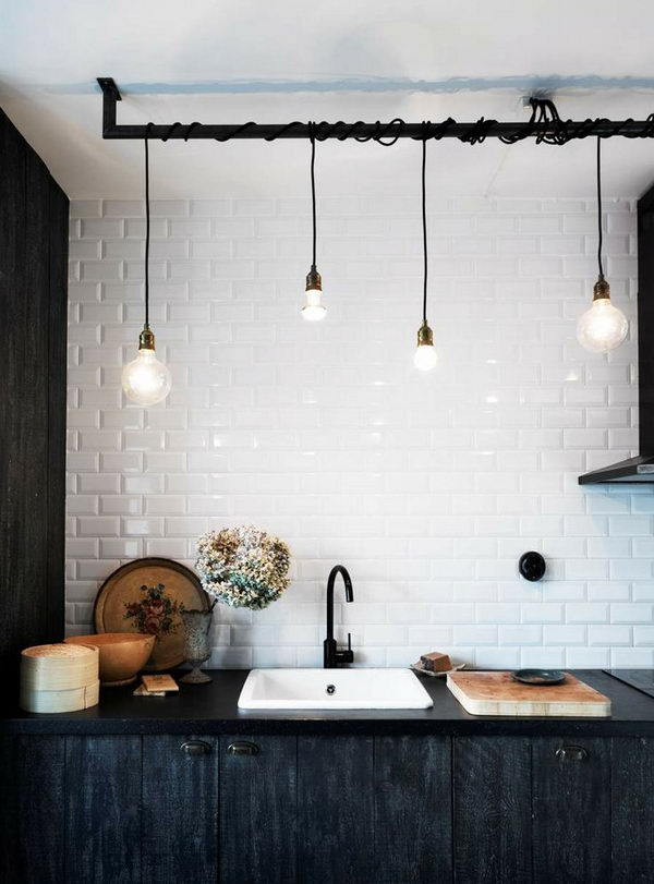 Unfinished Basement Ceiling Lighting Idea. Wrap the light on painted exposed pipes at different heights.