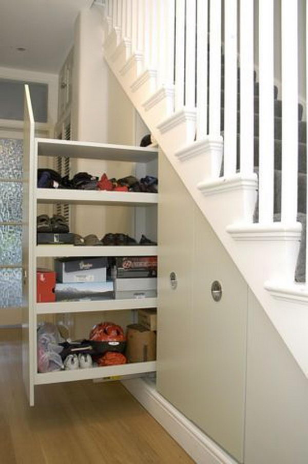 Pull-out Storage Under Stairs. Tall broom cupboard with pull-out under stairs storage.