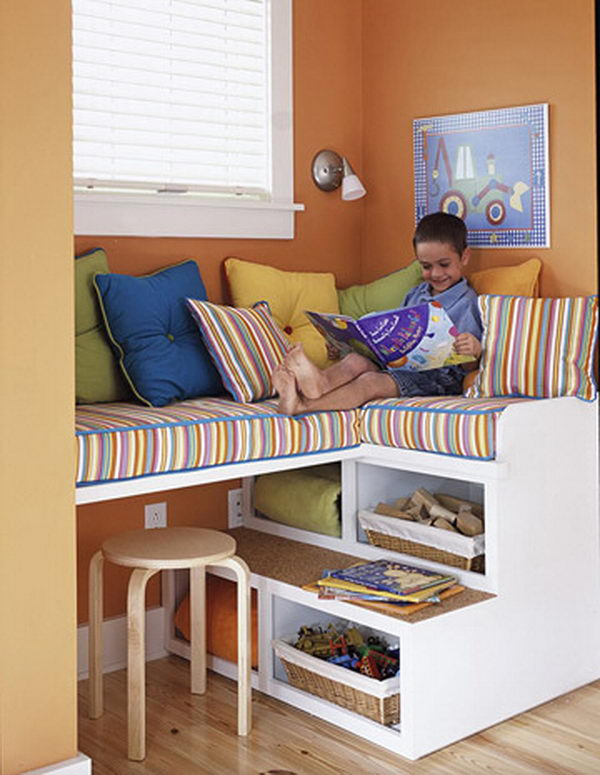 Stairs as Storage. This unique storage unit doubles as fun seating for kids, who can climb up to reach the cozy cushions above. The open shelves are perfect for housing blankets that can be easily obtained on those chillier days.