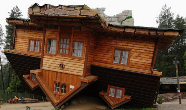Upside Down House (Szymbark, Poland). A famous vacation spot with many guests entering the model village.
