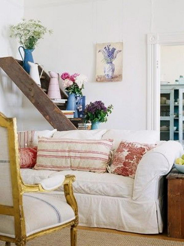 Ladder Shelf. The old ladder was used as a lovely display shelf behind a couch.