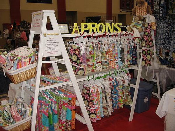It's fun and easy to display clothes using such painted ladders.