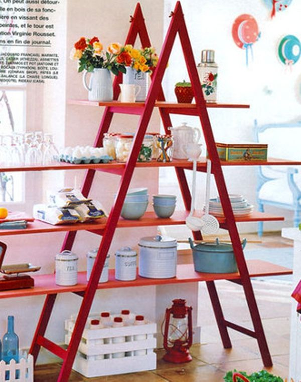 It is a creative decorating idea to have a Red Ladder Shelf in your room.
