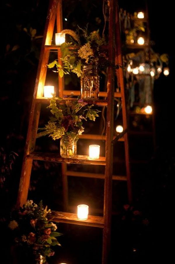 It's neat garden party idea with jars and candles on a ladder.