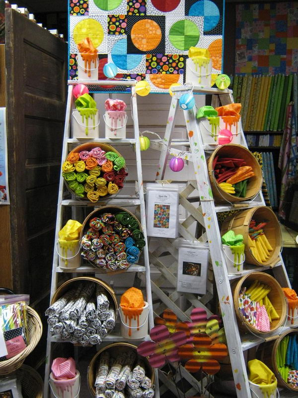 It is a decorative use of vintage ladders for arts and crafts show display, or retail store fixture.