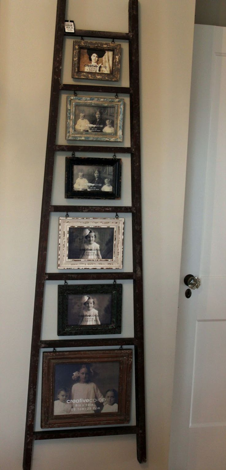 Ladder picture display- Just hang hooks under each step and attach photo.