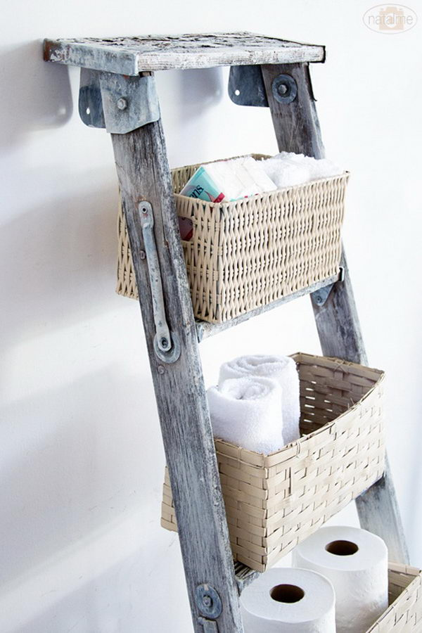 DIY basket ladder storage: Make use of vertical space and add baskets to on old ladder.