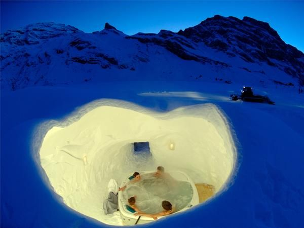 Iglu-Dorf Hotel in Switzerland. Built from scratch every winter, it takes almost 3000 tons of snow to create each Igloo. Standard village consists of Igloo Hotel, Igloo Bar, series of tunnels, and smaller Igloos that serve as private rooms.