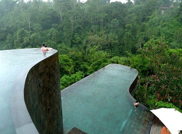 Ubud Hanging Gardens Hotel in Bali. This hotel has a towering, multi-leveled infinity pool that looks like a natural cliffside and was in fact designed to mimic the surrounding hills. In addition to the two main pools, each of the 38 guest rooms at Ubud has its own mini infinity pool with views of the nearby Pura Penataran Dalem Segara temple.