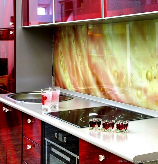 Printed glass backsplash. Not only protect the walls from staining, but also add a decorative touch to your kitchen design.