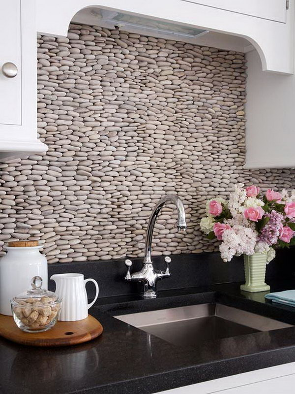Stacked pebbles for backsplash. Not only protect the walls from staining, but also add a decorative touch to your kitchen design.