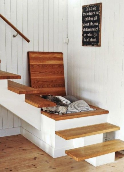 hidden stair storage. The space under a staircase can be used to keep  everyday clutter
