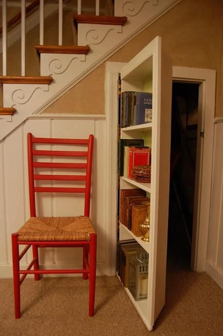 secret bookcase under stairs. The space under a staircase can be used to keep everyday clutter out of the way.