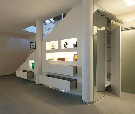 under stairs closet. The space under a staircase can be used to keep everyday clutter out of the way.