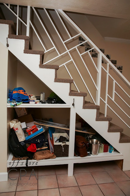 staircase storage panels. The space under a staircase can be used to keep everyday clutter out of the way.