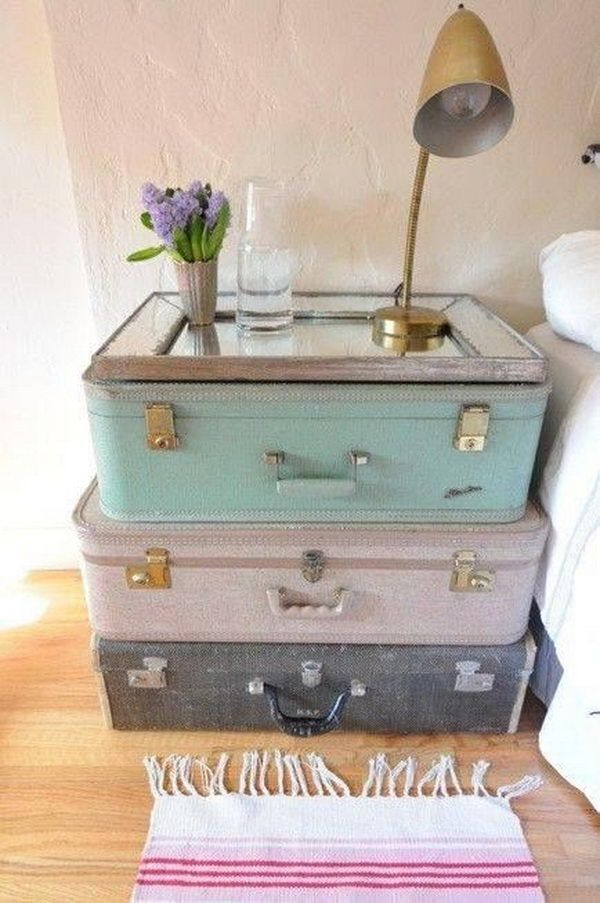 Stacked on top of one another, two or three suitcases can serve as an eye-catching, yet perfectly functional DIY nightstand.
