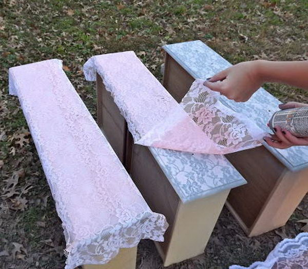 Transform furniture with lace and spray paint.