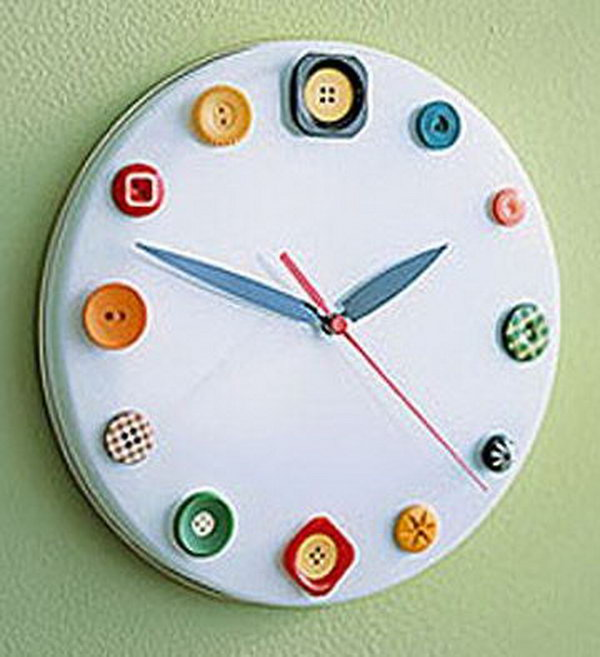 Button clock made out of a cookie tin lid, buttons, and clock parts. It is a great idea to help kids learn to read time.