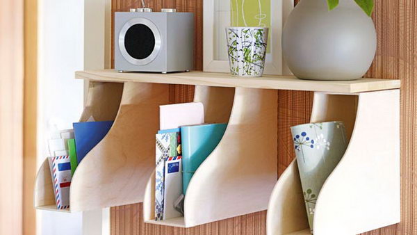 Put a few magazine holders under a shelf and you can create a space for mail and accessories.