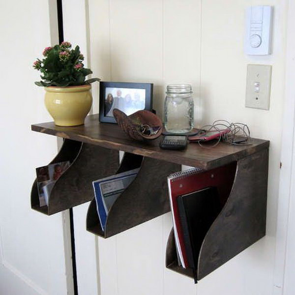 Make a handy storage station with a shelf and a few IKEA magazine holders. Position this right by the door, and never again will you wonder where your keys or phone wandered off to.
