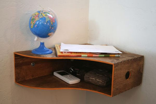 This wooden magazine holder from ikea turned out to be the perfect catch-all shelf for little items like keys, accessories and bills. All you had to do was put a coat of stain on it, turn it on its side and mount it in the corner of our entryway.