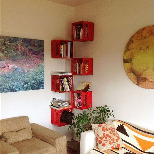 A floating corner bookshelf made from milk crates.