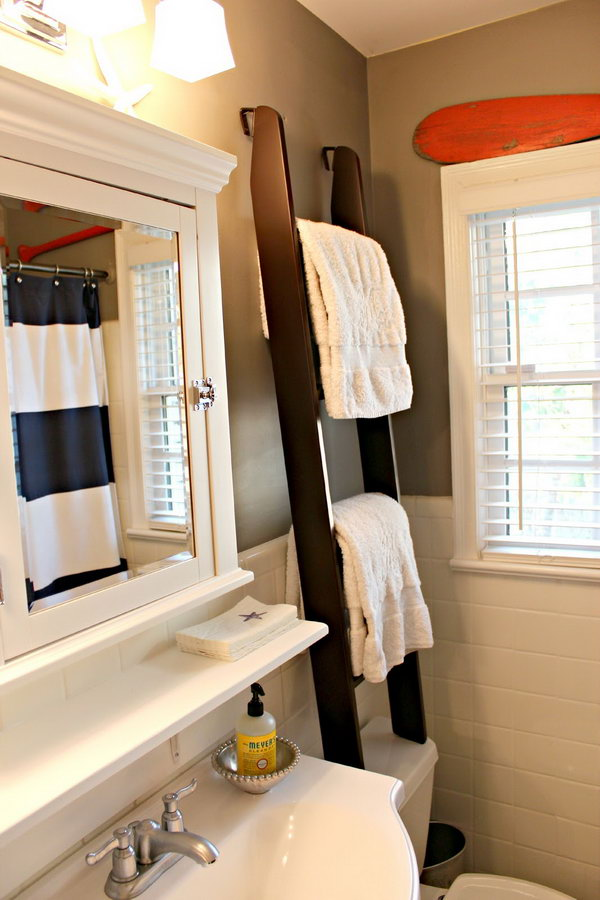 This ladder towel rack over the toilet was used for towel storage and visual height for the small space.