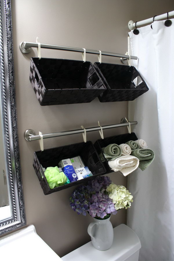 Hang these baskets over the toilet to store toiletries, wash cloths or hand towels and they look good doing it.