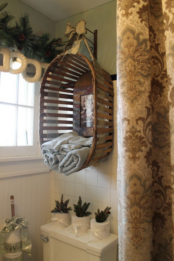 Upcycle an old wooden basket into a bathroom towel holder over the toilet.