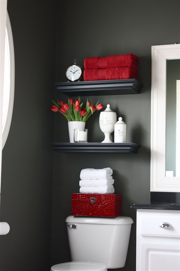 Floating shelves were installed over the toilet for additional storage. Filled with bathroom necessities and a few pretty things, it doubles as a welcoming display.
