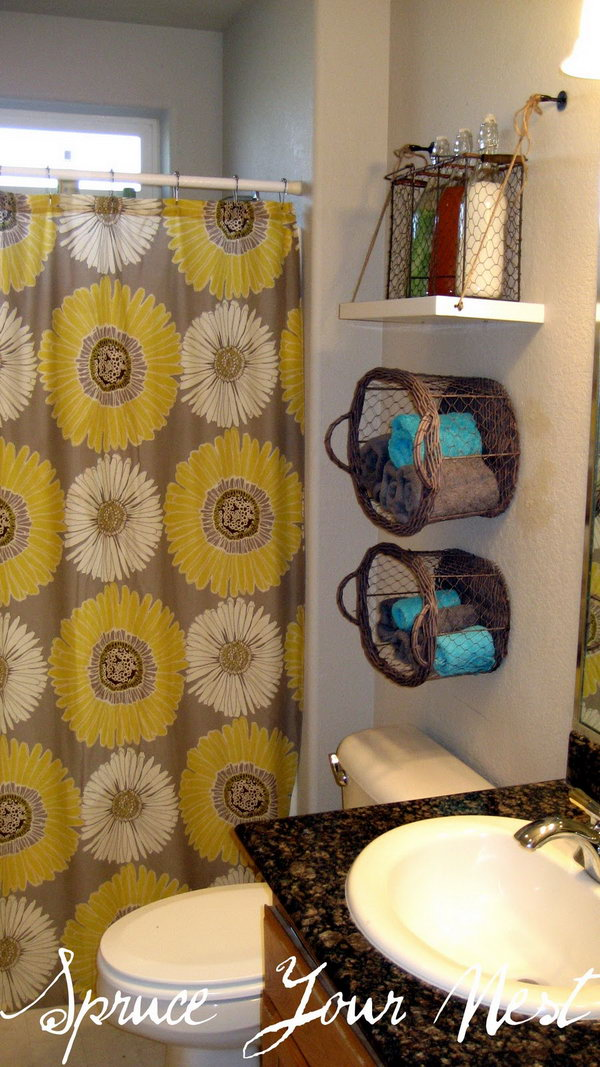 Hang baskets and shelves on the wall over the toilet for more extra space.