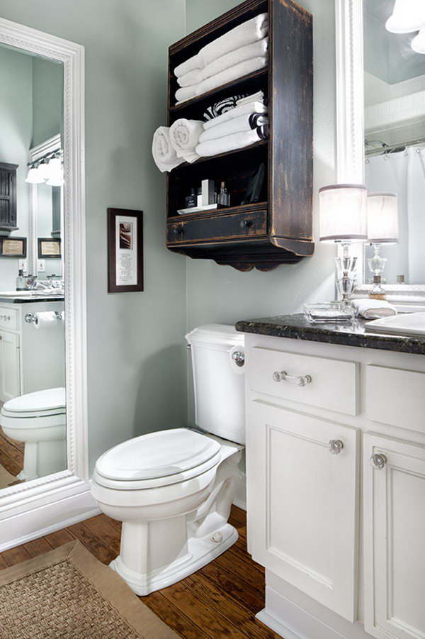 Cabinet above the toilet for extra bathroom space.