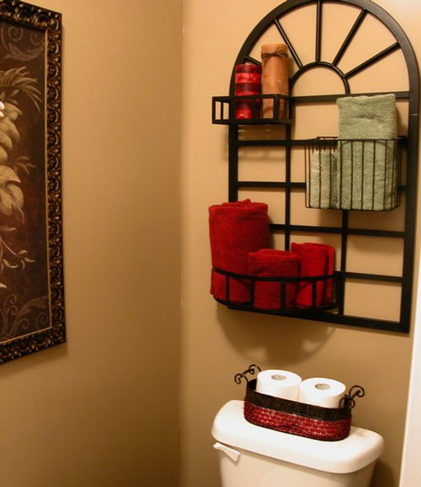 What a great idea with this pot rack over the toilet for storage and display.