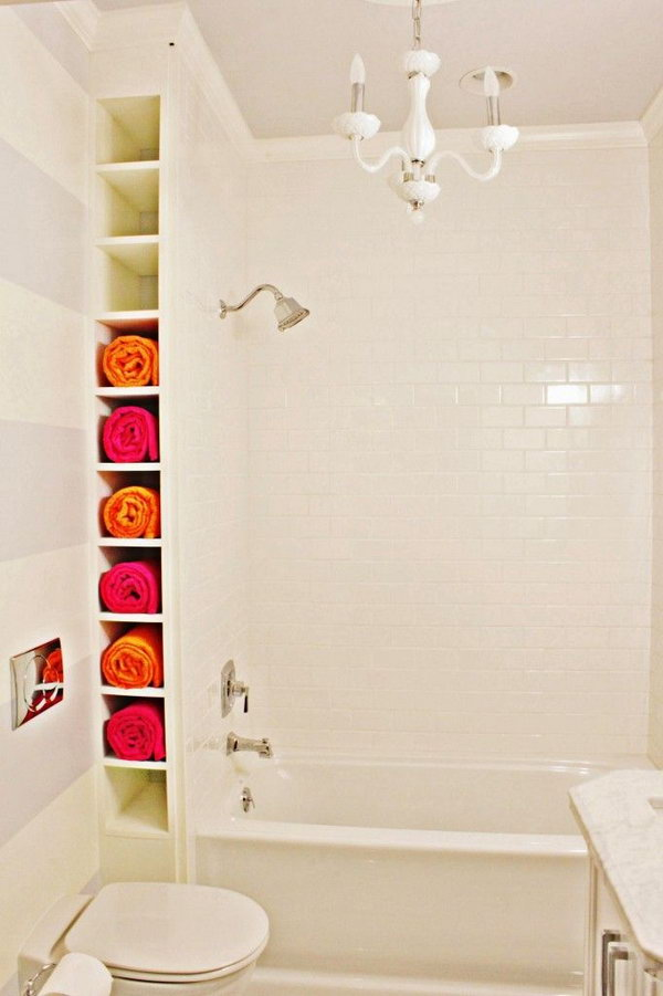 A nook by the tub. Create a ceiling-height rack between wall and tub. The space may be small but they're perfect for storing rolled towels.