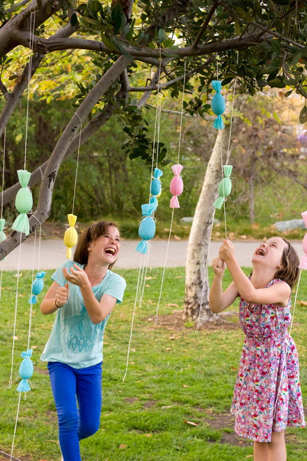 DIY Egg Popper Tree. Wrap the candy filled poppers like little egg-shaped candies. Hang these up on a tree and let the kids pull and pop, gathering candy as they go. This is a cool and fun Easter egg hunt idea.
