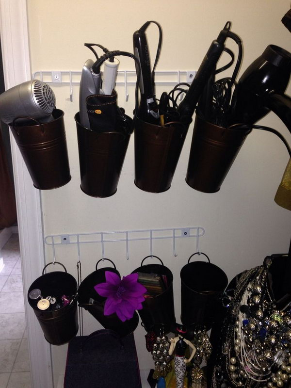 Bucket Storage. Hang the metal buckets on the wall to organize hair dryers and curling irons. You can also label these buckets to easily find what you want.
