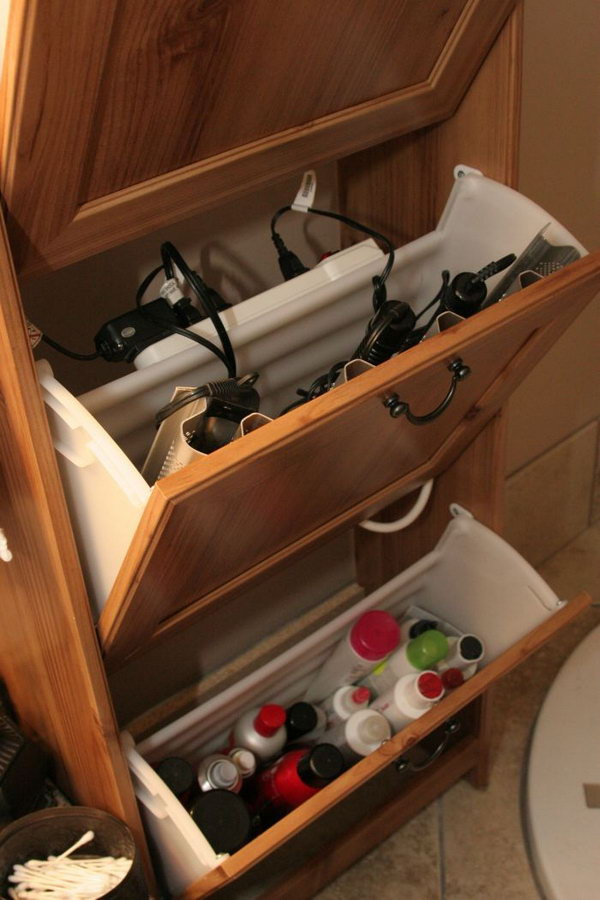 Use an Ikea shoe cabinet to store your curling irons, hair dryer and power strip.