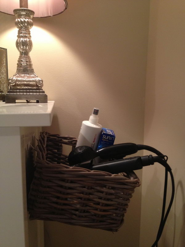 Organize Hair Dryer on Side of Dresser. Use 3M hooks and a basket to build a DIY hair dryer storage solution.