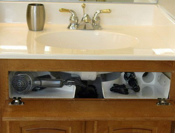 Curling Iron Holder Under Bathroom Sink. Install the storage unit behind your bathroom cabinet's false front around the base of your sink basin. Free up wasted space in your cabinets and drawers and help clear off your countertops.