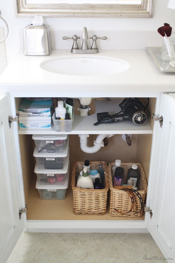 Add a shelf that was cut out for pipes in the cabinet. Use storage space above the shelf for hair dryer.