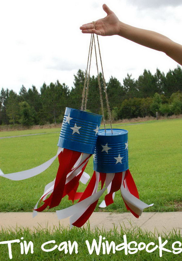 4th of July Tin Can Windsocks. What a cute idea to make these tin can crafts and decorate your yard for the 4th of July.