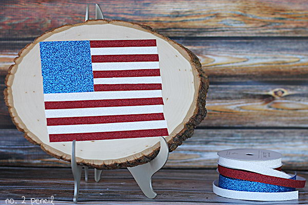 Glitter Tape Flag. Chic rustic craft made from pretty red, white, blue tapes, and wood slices.