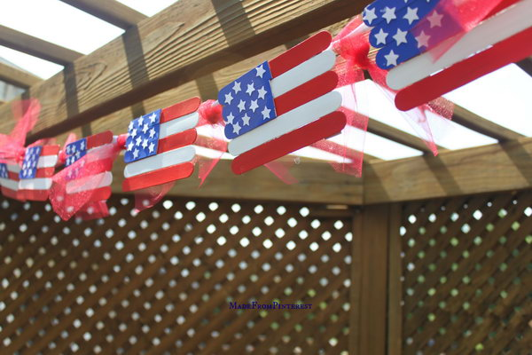 Popsicle Stick Flags. It is fun painting and gluing them to put this terrific banner together. You could even glue a paint stick to the bottom of the flag and use them as fans to cool you off on a hot Fourth of July.
