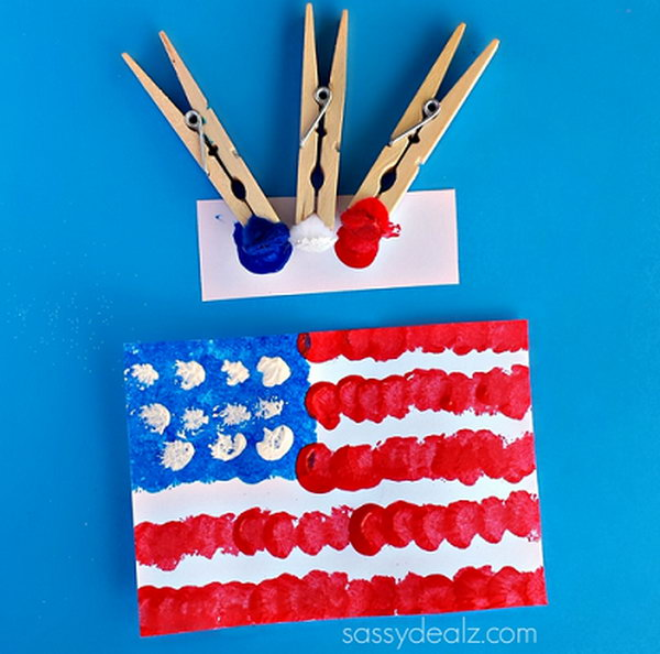 Pom-Pom American Flag Painting Craft for Kids. Sometimes using a regular paintbrush can get boring so grab some clothespins and pom-poms to make a cool American flag craft. This is fun and easy for kids to do on the 4th of July or Memorial Day.