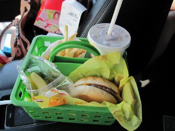 You can buy a cheap basket as a food holder in the car for your kids to keep food from getting spilled all over your car. Besides, this organizer has three compartments so everything has a place for your convenience.