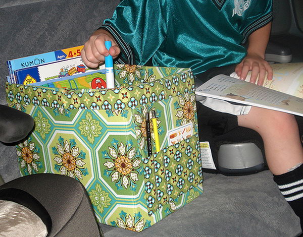 If you have children of any age in the car during the travel, making a tote like this is a must. You can put kids toys, crayons, comic books, LEGOs or anything else that keep your kids busy during the travel so that they will not be lost under the seat.