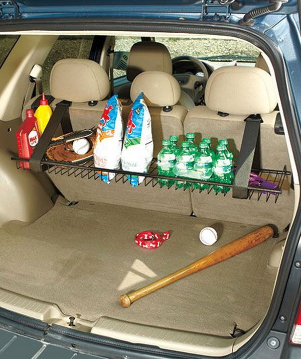 You can design a sturdy metal rack hanging from the rear seat of your vehicle with fabric-magic straps. It is a storage of grocery bags, sports equipment, drinks and more. Besides, you can fold it up when not in use so that it is out of the way against the back of the seat.