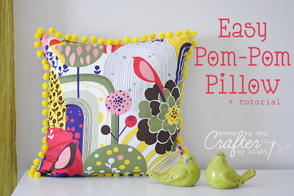 Easy Pom-Pom Pillow: The fabric is so vibrant and the matching yellow pom poms around edge are a great touch. Learn how to do