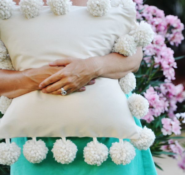 Mondo Pom Trim Pillow: This looks like so much fun to make. You can do it in any color, and add glitter if you want. See how to do it