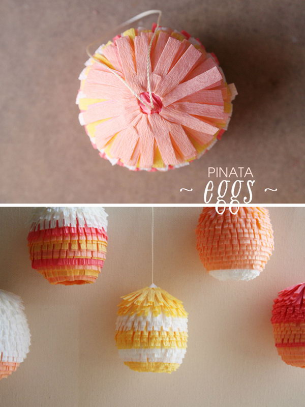 Cute Easter Pinata Eggs. DIY these pi?ata Easter eggs with blown-out jumbo chicken eggs, floral crepe paper, thread, glues and toothpicks. They are easy to make and will definitely brighten up your celebration.
